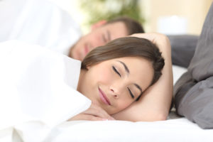 women sleeping to improve immune system