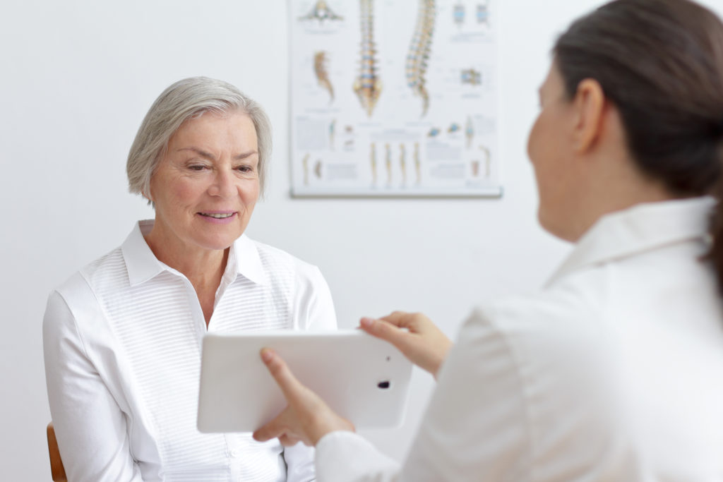 senior patient talking to doctor about osteoporosis