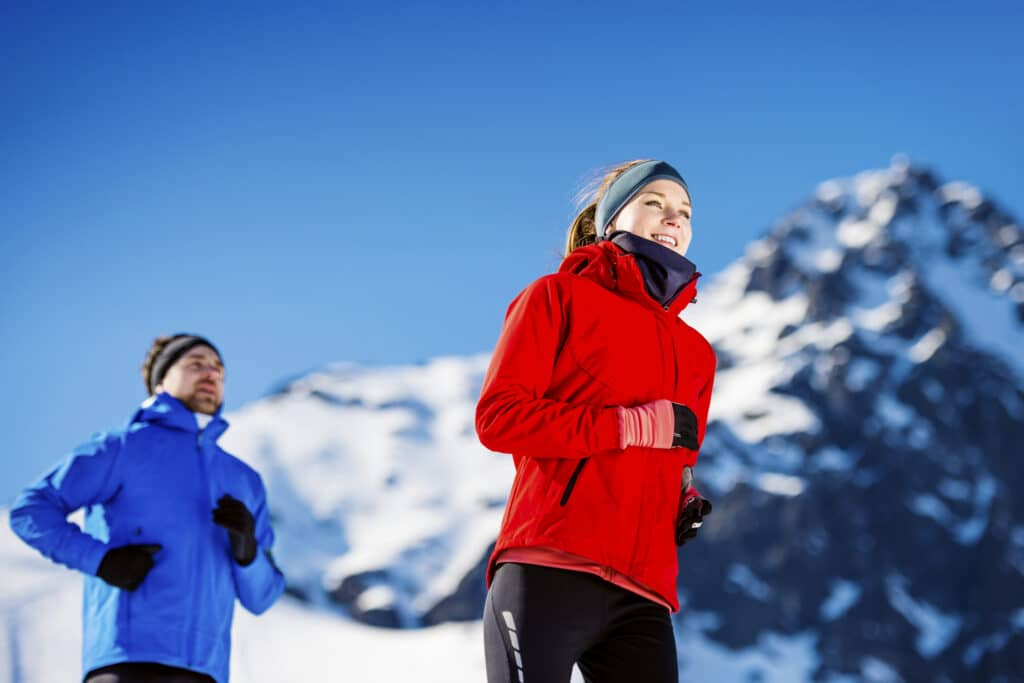 healthy couple jogging in the mountains