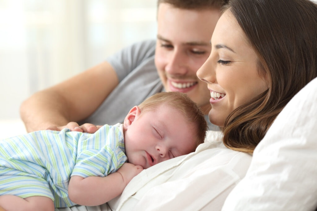 couple holding a baby